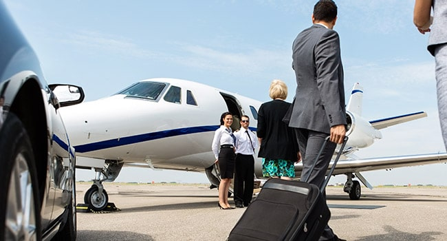Business person about to board a private jet